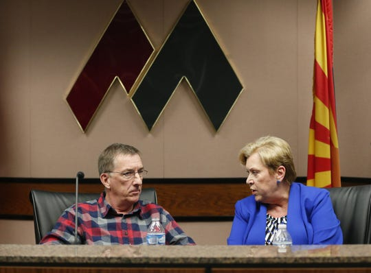 Former board president Laurin Hendrix (left) speaks with newly elected board President Linda Thor after a special meeting of the Maricopa County Community College District Governing Board in Tempe January 15, 2019.
