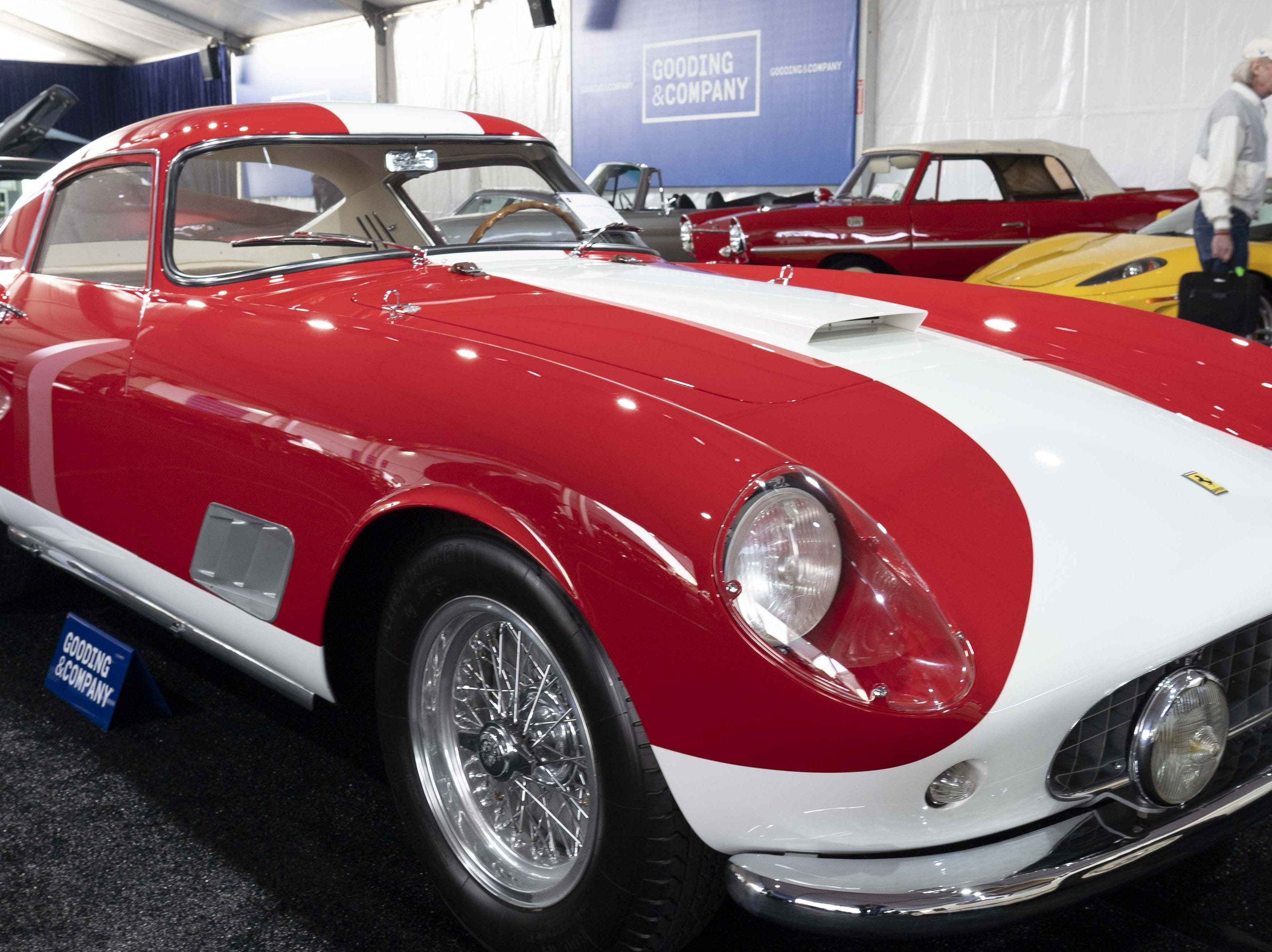 Car fans look at the 1958 Ferrari 250 GT Tour de France Berlinetta car for auction at Gooding & Co.'s preview day in Scottsdale.