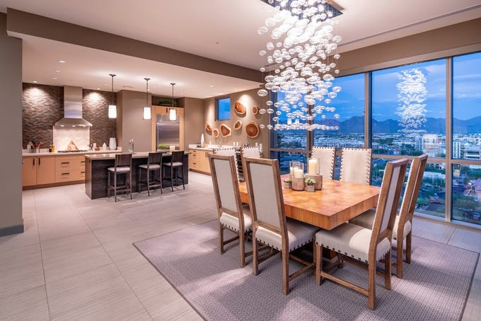 This Scottsdale penthouse condo, purchased by JoAnn L. Musselman, includes floor-to-ceiling windows and artistic lighting.