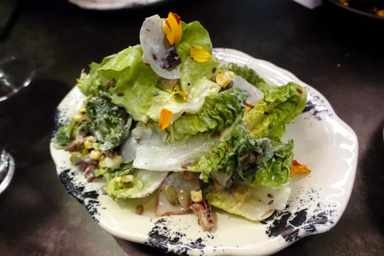 Little gem lettuces with freeze dried corn, seeds, nuts, grains, Tender Belly bacon and chilled buttermilk dressing at The Larder + The Delta in Phoenix.