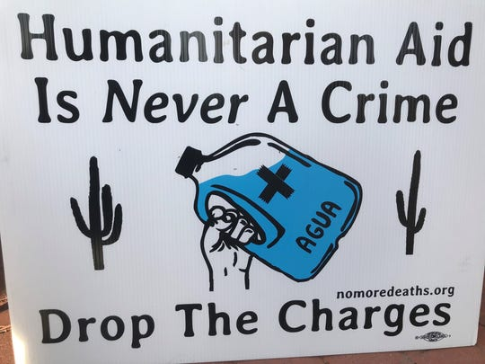 No More Deaths volunteers put up these signs around Tucson ahead of the trial of four volunteers charged for dropping off water for migrants at the Cabeza Prieta National Wildlife Refuge.