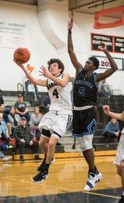 Richmond High School guard Daveyon Henderson (5) jumps to block Marine City's Johnathan Mistretta  during their basketball game Tuesday, Jan. 15, 2019 at Marine City High School.