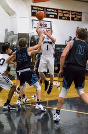 Marine City's Jack Kretzschmar (1) shoots the ball during their basketball game against Richmond High School Tuesday, Jan. 15, 2019 at Marine City High School.