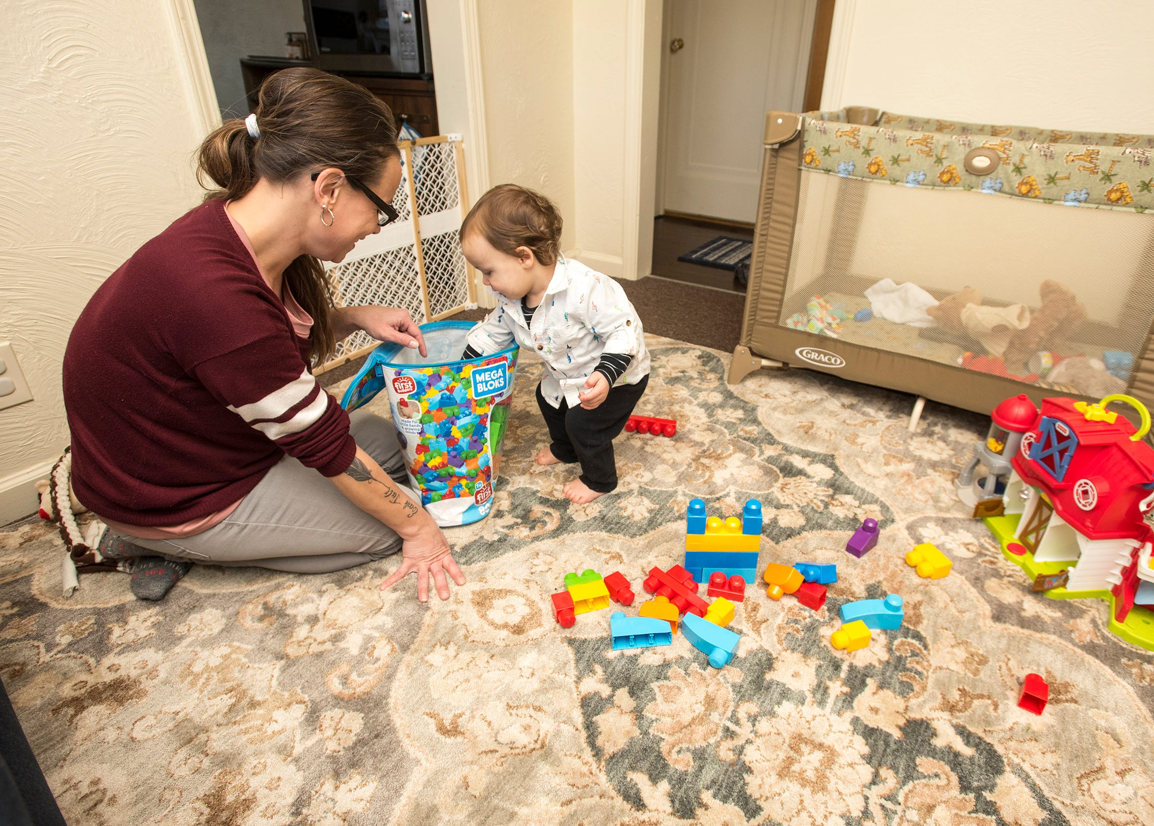 Aarin Leist plays with her 1-year-old son Ethan Wednesday, Jan. 16, 2019 at her home in Port Huron.