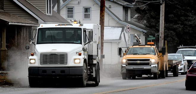 A street sweeper operates along Roosevelt Ave. in York City Wednesday, Jan. 16, 2019. York City Council voted unanimously this week to lower the finefor violating the street sweeping ordinance, but the costs for other parking tickets will increase in 2019.Bill Kalina photo
