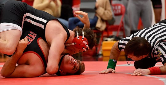 Susquehannock's Luke Ohmann earns back points on John Bradbury of Dover during the 220 pound match, Tuesday, January 15, 2019