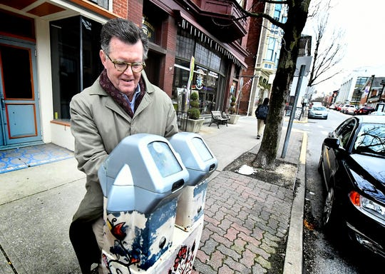 Fred Callahan of Dover Township feeds a meter while parking on North Beaver Street Wednesday, Jan. 16, 2019. York City Council voted unanimously this week to lower the fine for violating the street sweeping ordinance, but the costs for other parking tickets will increase in 2019. Bill Kalina photo