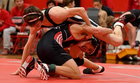 Susquehannock's Garrett Bortner, top, and Tanner Linker of Dover wrestle a close bout at 120 pounds to decide the team match, Tuesday, January 15, 2019. Bortner won the bout 11-5 giving the Warriors a 39-34 win.John A. Pavoncello photo