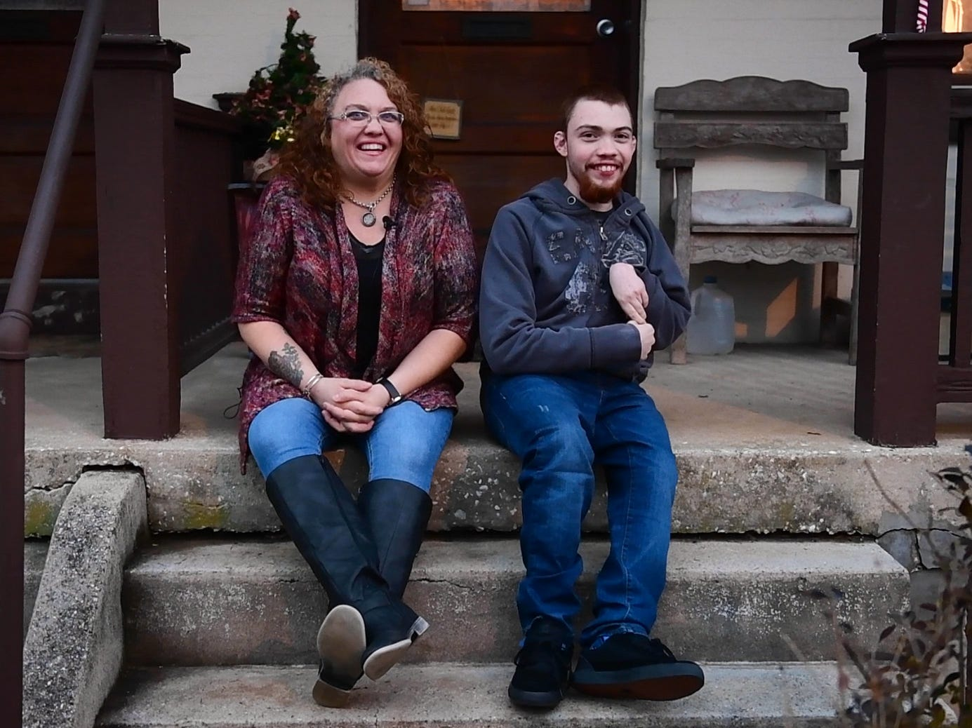 Hunter Leisenring (right) and his mother, Yvette Wertz (left), share the story of Hunter's 16th birthday surprise from their front porch, January, 8, 2019.