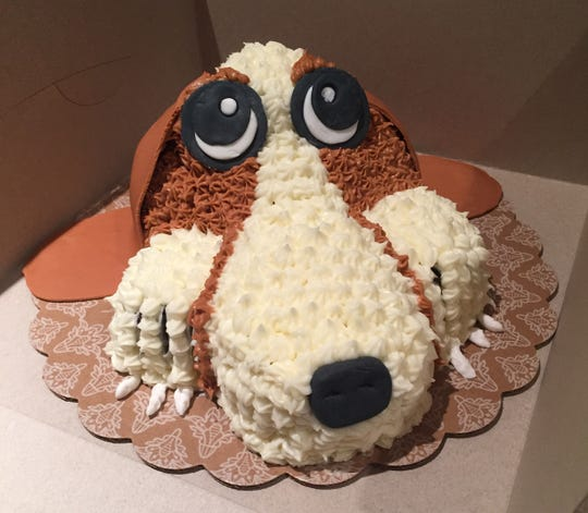 Custom cakes fashioned by Anne DeAngelis of A Bakery Built for Two include this basset hound birthday cake.