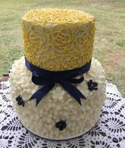 A lemon blackberry wedding cake from A Bakery Built for Two features hand-piped lace.