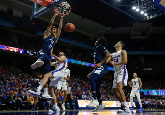 Nevada forward Trey Porter dunks  over Boise State forward David Wacker (33) during the first half of Tuesday's game in Boise.