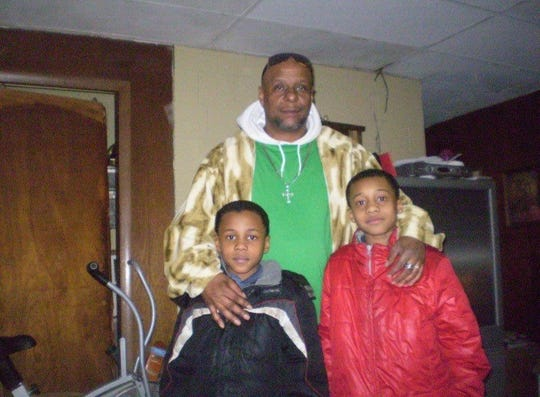 Richmond High School junior Koream Jett, left, with his father Shawn, center, and brother Tylen, right.