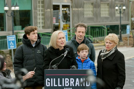 Presidential candidate, U.S. Sen. Kirsten Gillibrand, with her family from left to right, son Theodore, husband Jonathan, son Henry, and her mother, Polly Rutnik, by her side, talks to a large gathering of media outside the Country View Diner on Wednesday, Jan. 16, 2019, in Brunswick, N.Y.