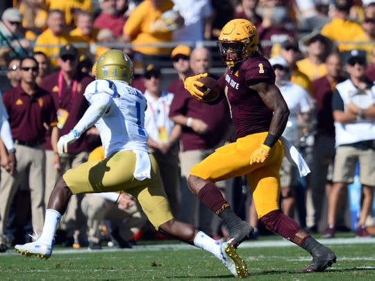 Arizona State Sun Devils wide receiver N'Keal Harry runs against UCLA Bruins defensive back Darnay Holmes.