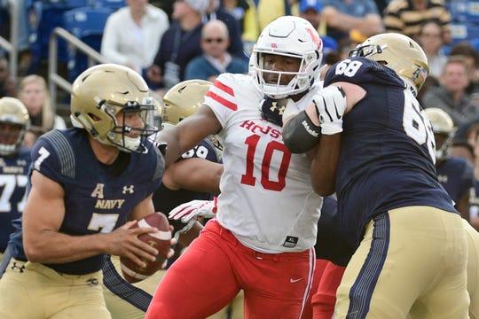 Houston Cougars defensive tackle Ed Oliver (10) applies pressure on Navy Midshipmen quarterback Garret Lewis (7) .
