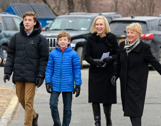 Presidential candidate, U.S. Sen. Kirsten Gillibrand, second from right, arrives at the Country View Diner with her sons, Theodore, left, Henry, second from left, and her mother Polly Rutnik on Wednesday, Jan. 16, 2019, in Brunswick, N.Y.