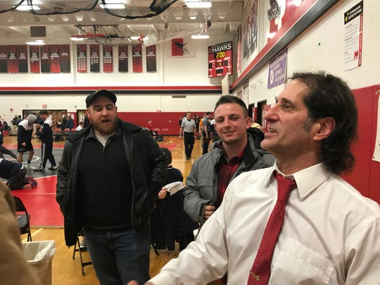 John Grillo, going down memory lane with a former member of one of the high school teams he coached over 44 seasons. Grillo said the 2018-19 season with Holley-Kendall is his final one.