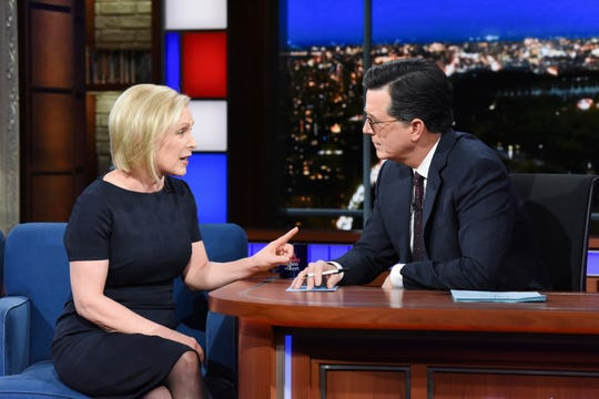 "This image released by CBS shows Sen. Kirsten Gillibrand, D- N.Y. with host Stephen Colbert during a taping of ""The Late Show With Stephen Colbert,"" Tuesday, Jan. 15, 2019 in New York."