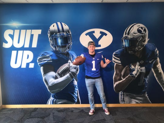West Valley grad Bailey Sulzer poses at a BYU football facility. Sulzer announced on Twitter that he will play football for BYU as a preferred walk-on after completing missionary work.