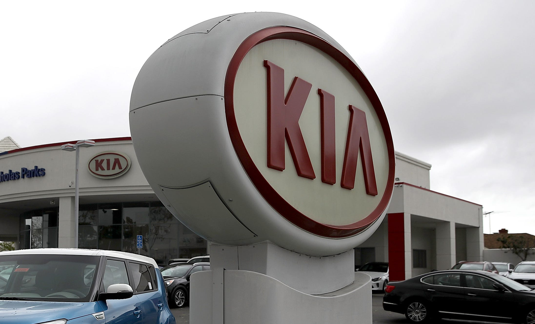 A sign with the Kia logo displayed at a Hyundai dealership on April 7, 2017 in San Leandro, California.