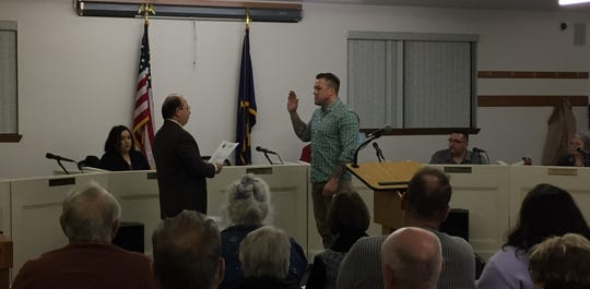 Derek Clevenger (right) is sworn in as mayor of Aumsville on January 15, 2019.
