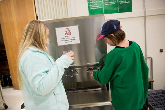 Students pour their own drinks from milk dispensers rather than milk cartons at Silverton Middle School on Monday, Jan. 15, 2019. Marion County was awarded a $76,000 grant to reduce food waste in schools.
