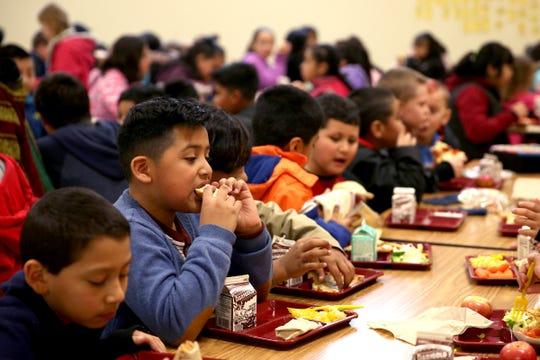 Third grade student Emmanuel Gonzalez-Kalafox eats lunch with his class at Auburn Elementary School in Salem on Wednesday, Jan. 16 2019.
