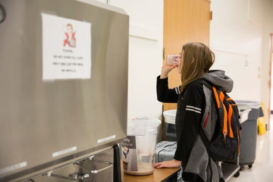 Sixth grade student Hunter Jenson, 12, drinks the rest of her milk before placing her cup in a bin at Silverton Middle School on Monday, Jan. 15, 2019. The Silver Falls School District is the first to participate in a waste reduction program that knocks out milk cartons.