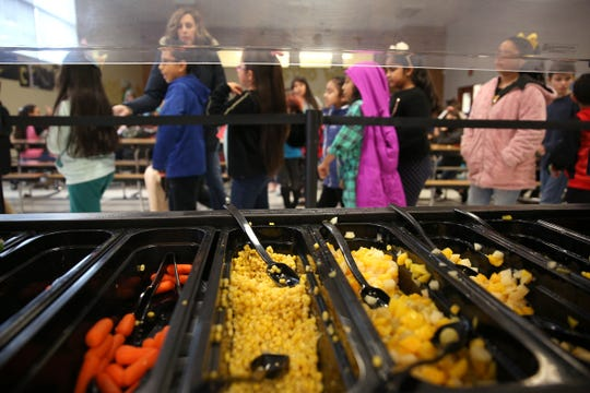 Students line up for lunch at Auburn Elementary School in Salem on Wednesday, Jan. 16 2019.