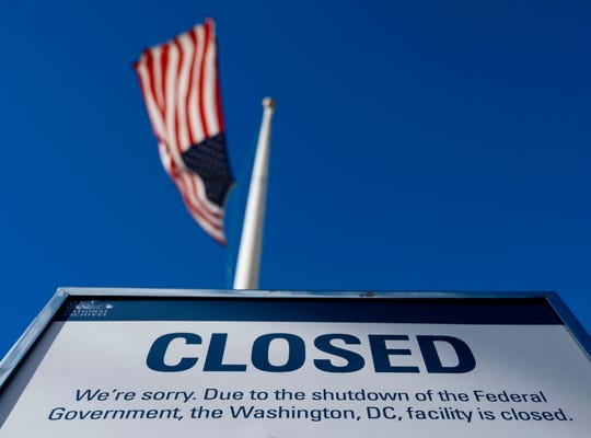 A sign is displayed on a government building that is closed because of a US government shutdown, in Washington, DC.