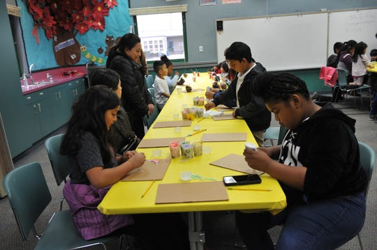 Students making art at the Alisal Family Resource Center in Salinas.