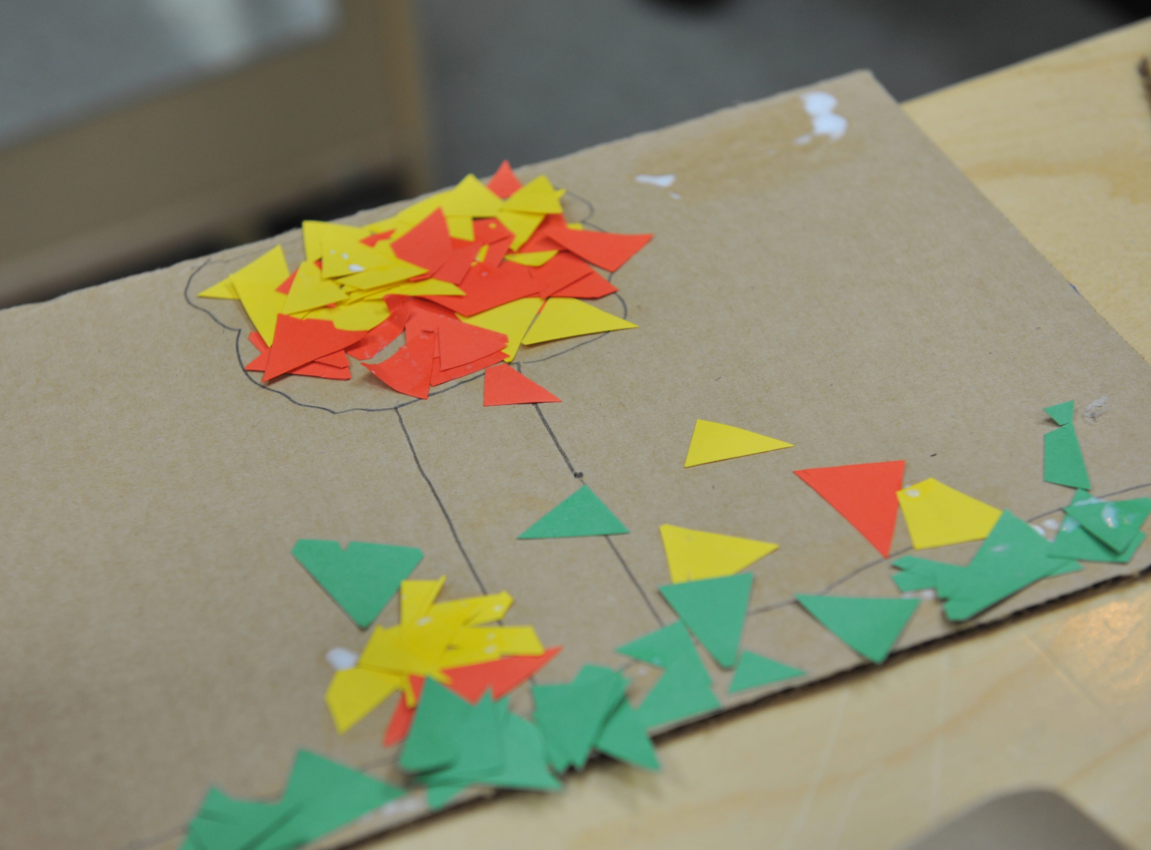 Andy Chan's mosaic, made of paper cutout triangles, depicts a tree in the fall.
