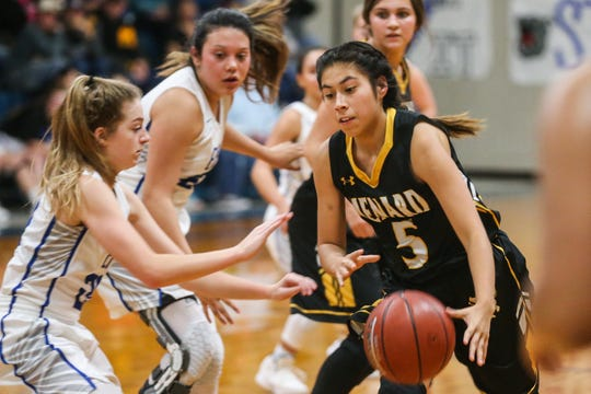Menard's Jalyn Montes dribbles the ball around Eden players Tuesday, Jan. 15, 2019, at Eden High School. Eden girls won 36-22.