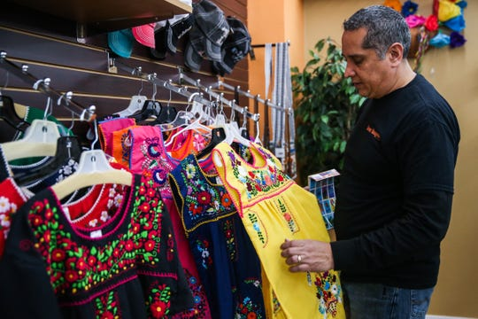 Hector Leos picks up a modern Mexican dress Wednesday, Jan. 16, 2019, at Leos Imports.