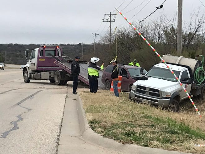 A 2006 Ford Focus is towed after a crash in the 2400 block of South FM 2288.