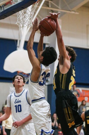 Menard's Kallin Kothmann (right) blocks the shot of Eden's Ethan Saucedo during a boys basketball game on Tuesday, Jan. 15, 2019, at Eden High School.