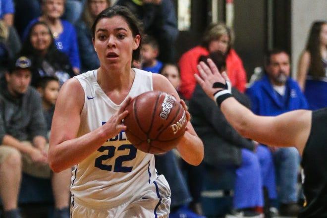 Eden's Emily Bunger passes around Menard Tuesday, Jan. 15, 2019, at Eden High School. Eden girls won 36-22.