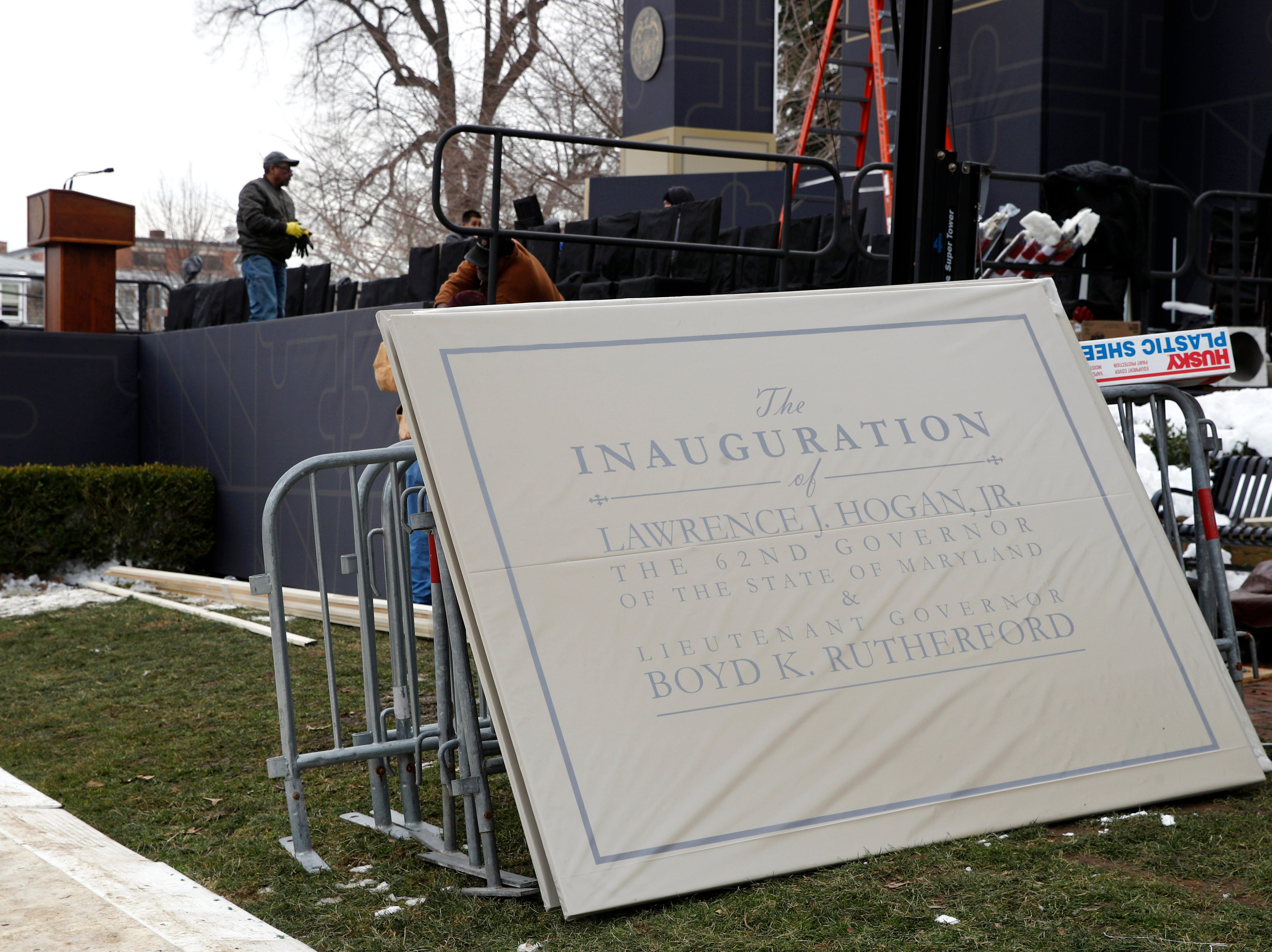 Signage waits to be installed as workers prepare a stage for Maryland Gov. Larry Hogan's inauguration ceremony Tuesday, Jan. 15, 2019, outside the Maryland State House in Annapolis.