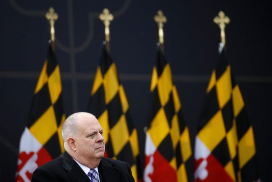Maryland Gov. Larry Hogan sits onstage during his inauguration ceremony Wednesday, Jan. 16, 2019, in Annapolis.