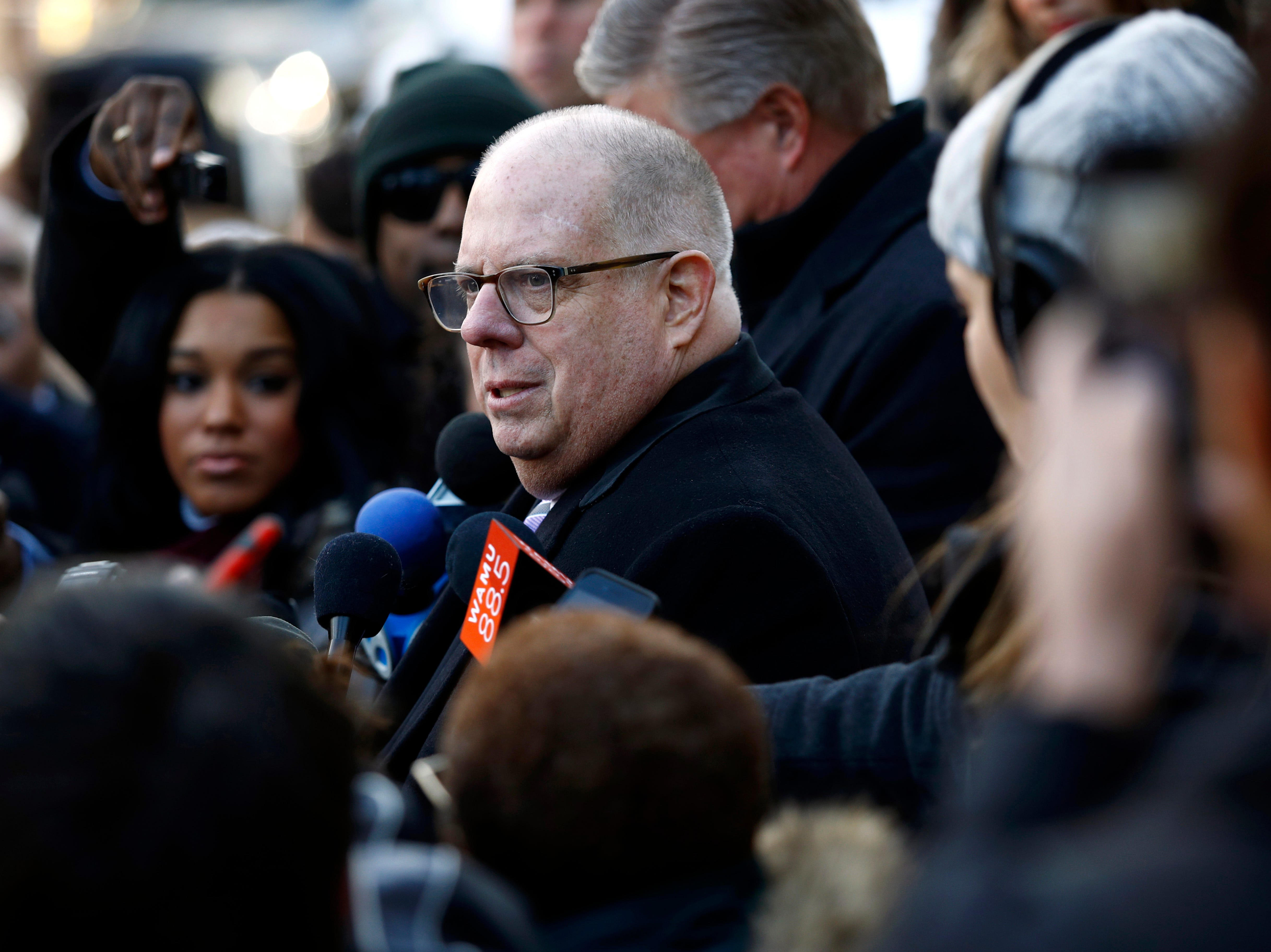Maryland Gov. Larry Hogan, left, speaks with members of the news media outside the Maryland State House before his inauguration ceremony Wednesday, Jan. 16, 2019, in Annapolis.