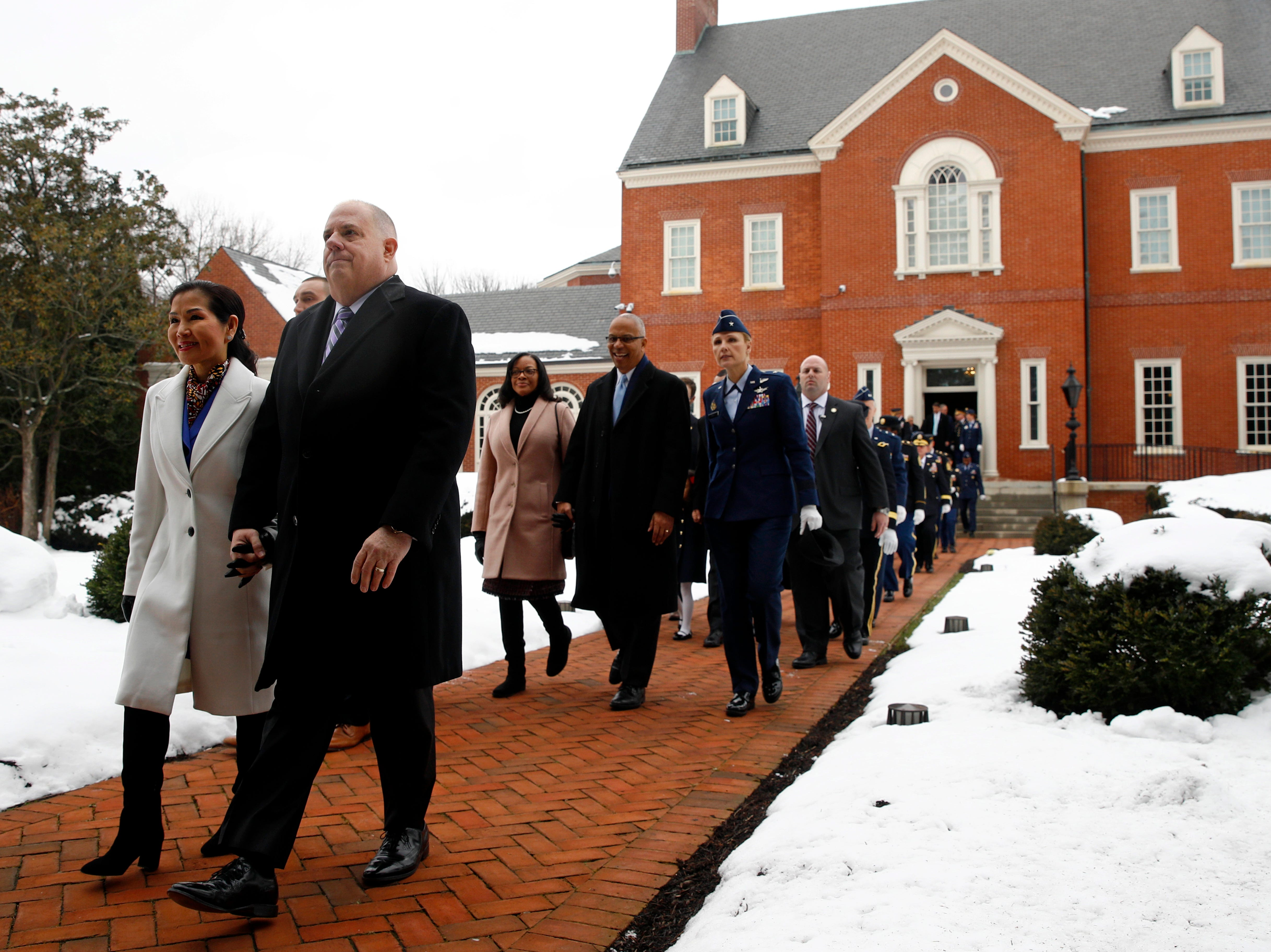 Maryland Gov. Larry Hogan, second from left, departs Government House, the Governor's mansion, with first lady Yumi Hogan before his inauguration ceremony Wednesday, Jan. 16, 2019, in Annapolis.