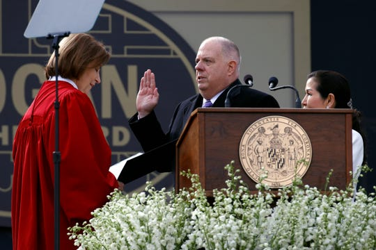 Maryland Gov. Larry Hogan, center, accompanied by his wife Yumi, right, takes a ceremonial oath of office administered by Mary Ellen Barbera, Chief Judge of the Maryland Court of Appeals, at his inauguration ceremony Wednesday, Jan. 16, 2019, in Annapolis.