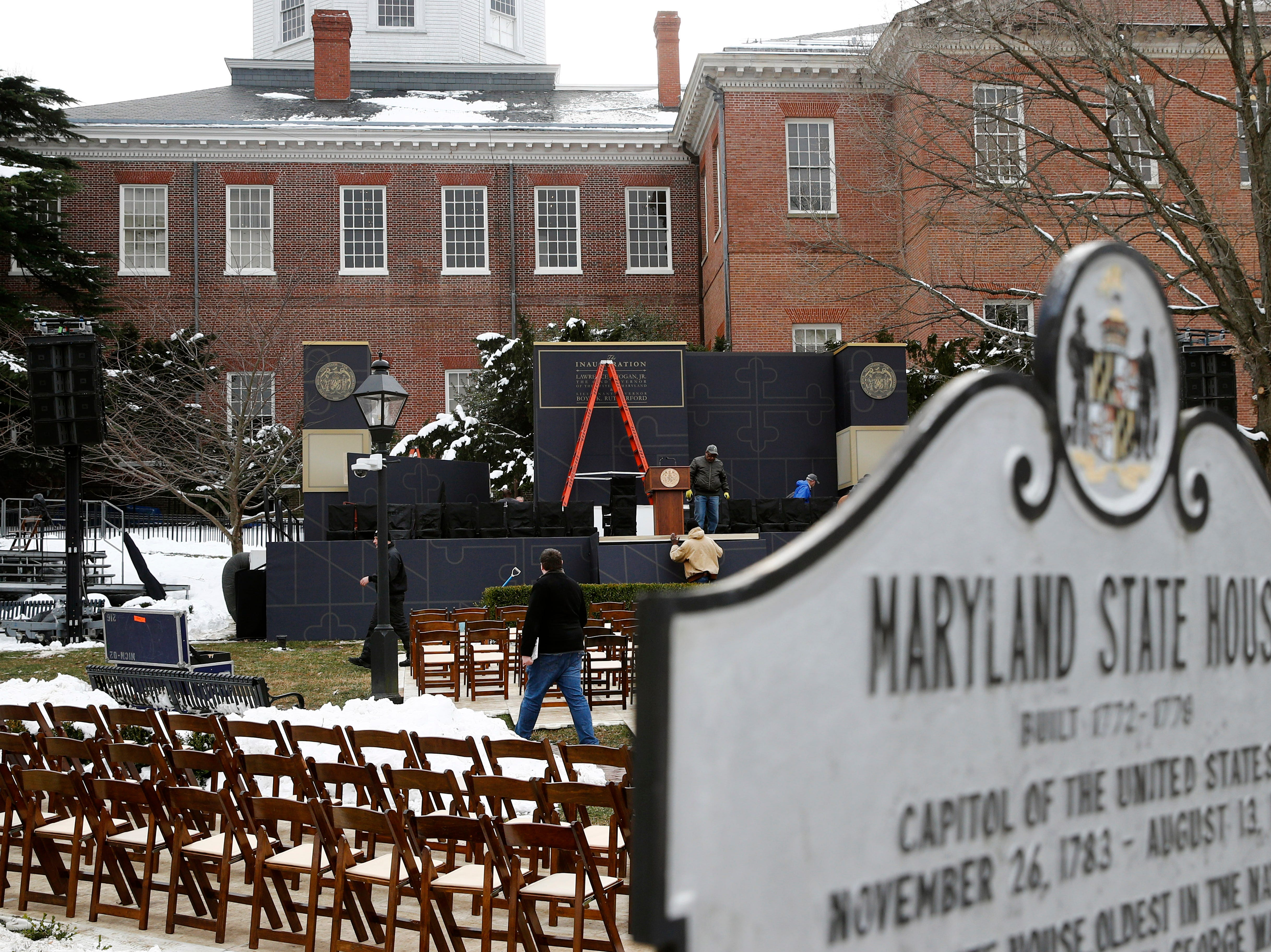 Workers prepare a stage for Maryland Gov. Larry Hogan's inauguration ceremony Tuesday, Jan. 15, 2019, outside the Maryland State House in Annapolis.