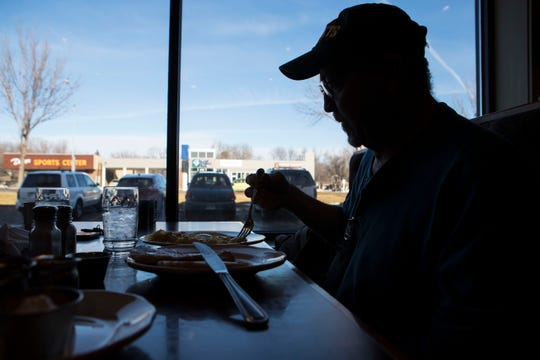 Charlie Winckler enjoys his free meal at Original Pancake House in Sioux Falls, S.D., Wednesday, Jan. 16, 2019. Original Pancake House is one of the restaurants in town are giving away free meals to furloughed federal workers during the shutdown.