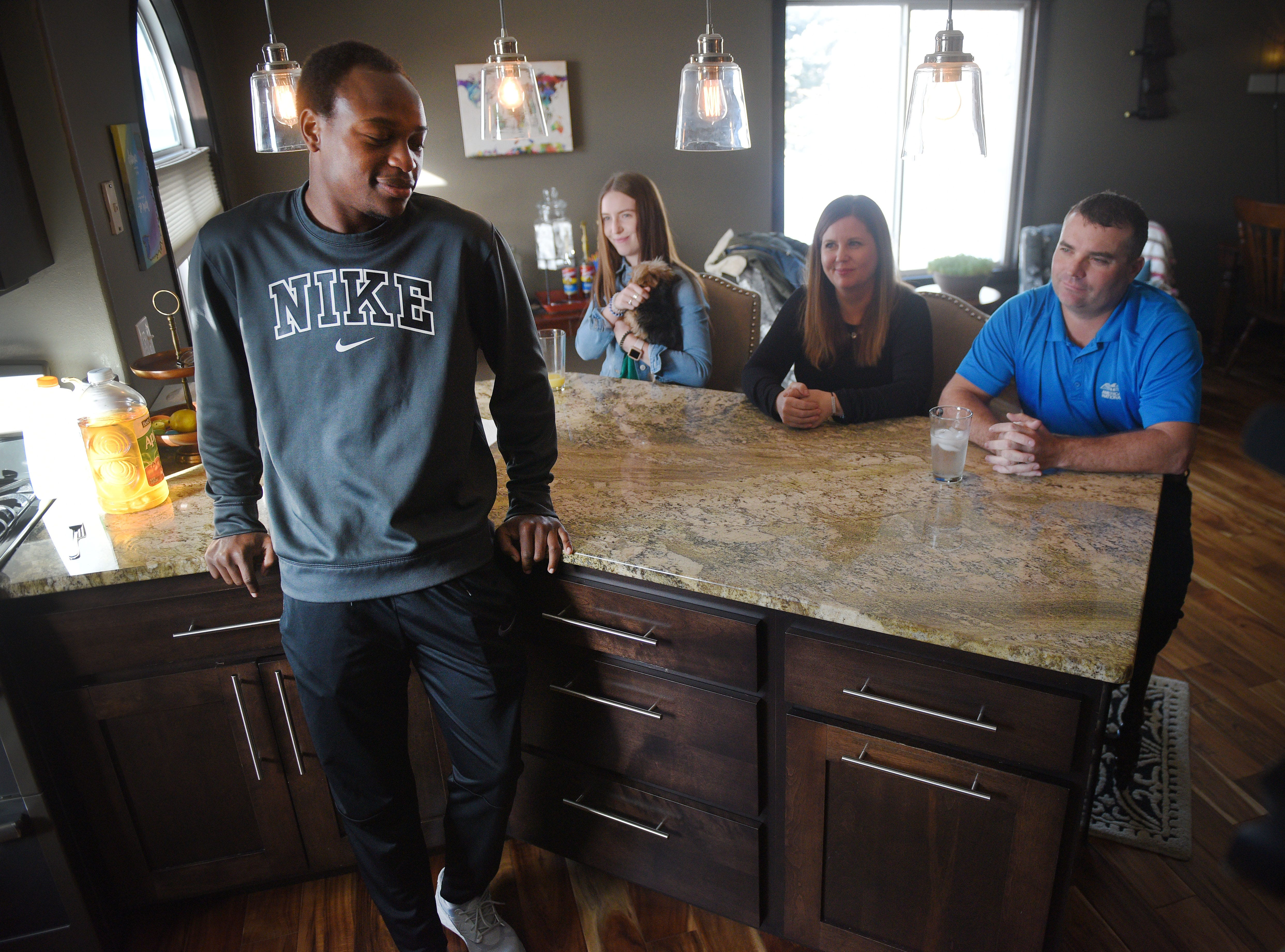 Doyle Brown talks with his guardians Shanley and Mike Dorris and their daughter Karsyn Wednesday, Jan. 16., after lunch at their home in Madison.