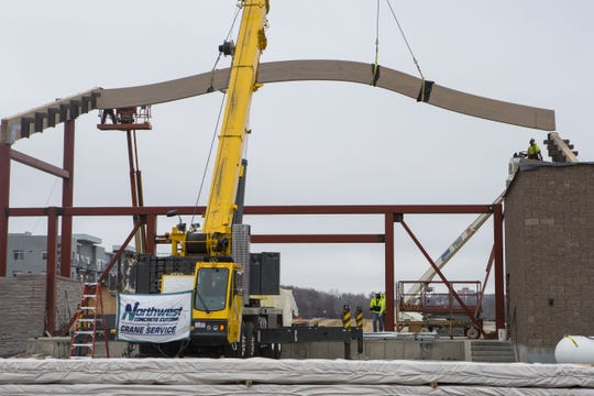The setting of the first beam of the Levitt Shell is shown at Falls Park West in Sioux Falls, S.D., Tuesday, Jan. 15, 2019.