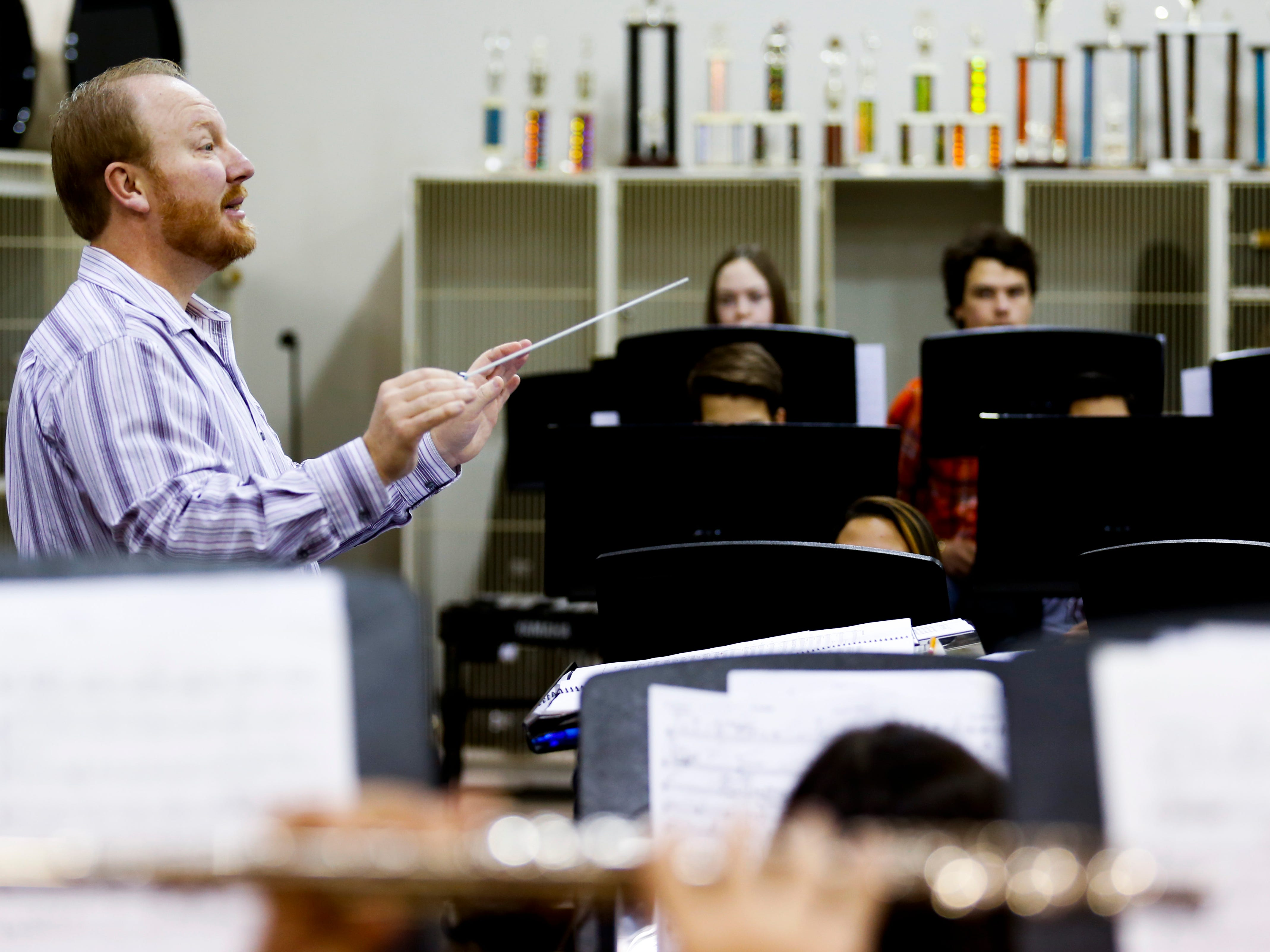 Central High School band director Chris Rohrbaugh leads the wind ensemble during class on Wednesday, Jan. 16, 2018. The 53-student wind ensemble will be featured at the annual state conference of the Missouri Music Educators Association next week.