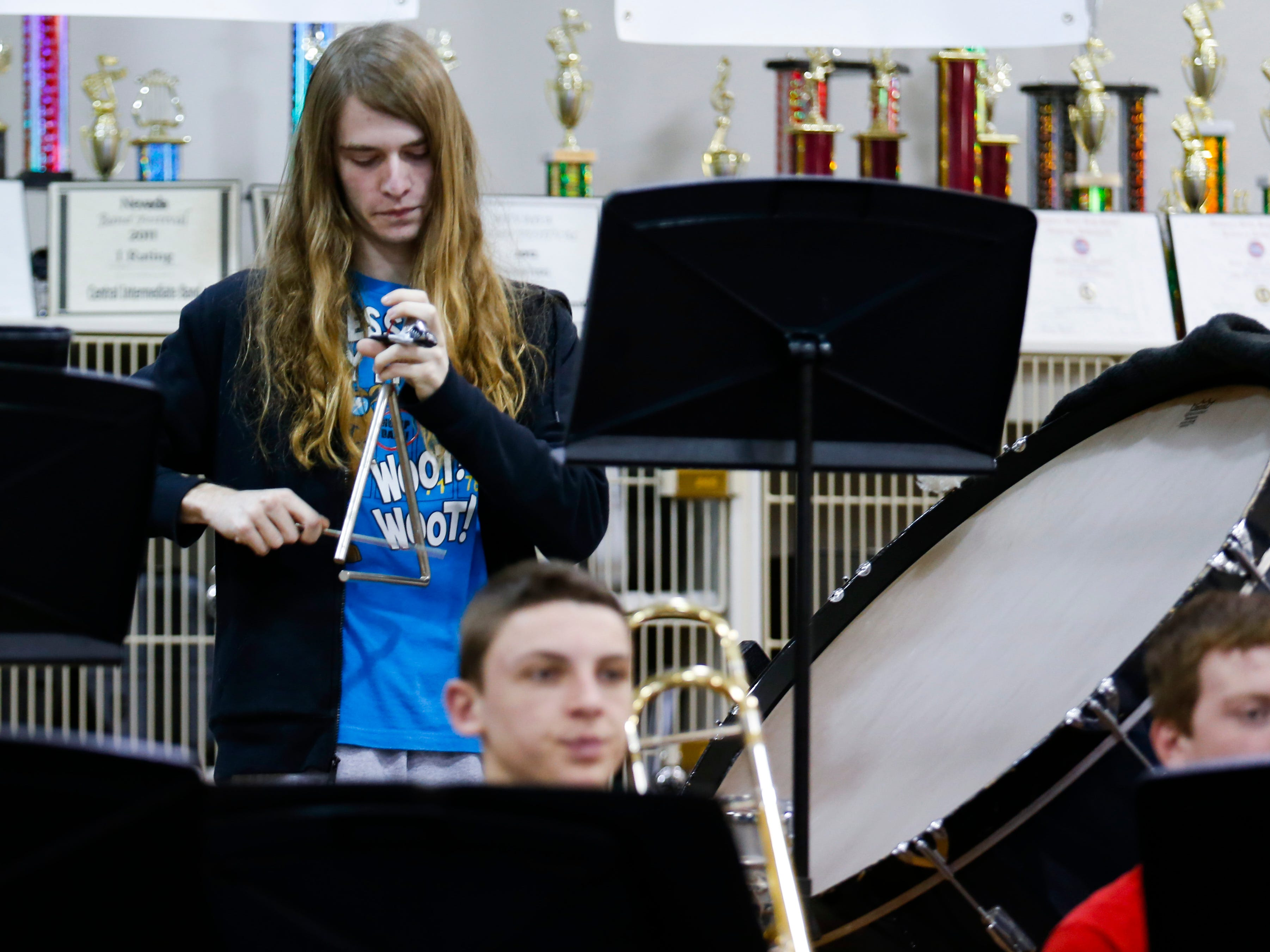 Jacob Sharp, a Central High School junior, plays the triangle during band practice on Wednesday, Jan. 16, 2018. The 53-student wind ensemble will be a featured at the annual state conference of the Missouri Music Educators Association next week.