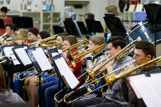 The trombone section of the Central High School wind ensemble practice on Wednesday, Jan. 16, 2018. The 53-student wind ensemble will be a featured at the annual state conference of the Missouri Music Educators Association next week.plays during